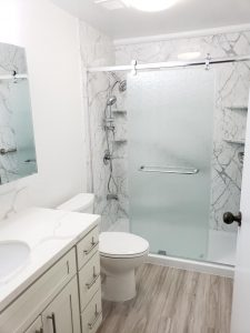 Mono Hot Springs Shower Remodel Calcutta Marble Wall Walk In Shower client 225x300
